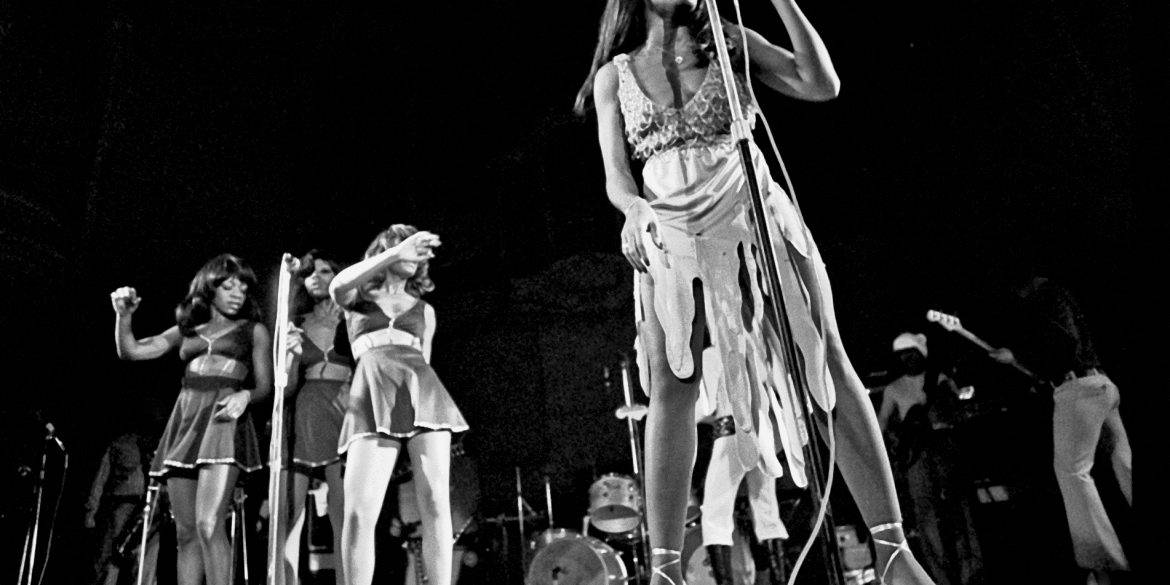 Tina Turner, Claudia Lennear, and The Ikettes performing on stage.