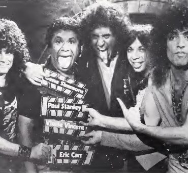 Eric Carr and the band Kiss.