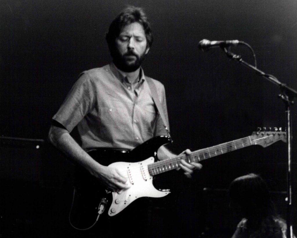 Eric Clapton playing guitar.