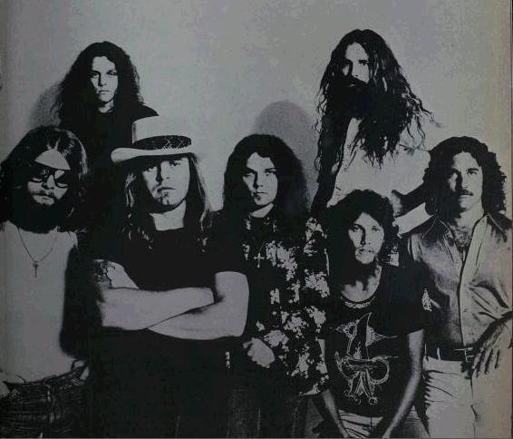 Steve Gaines and Lynyrd Skynyrd posing for an advertisement in 1977.