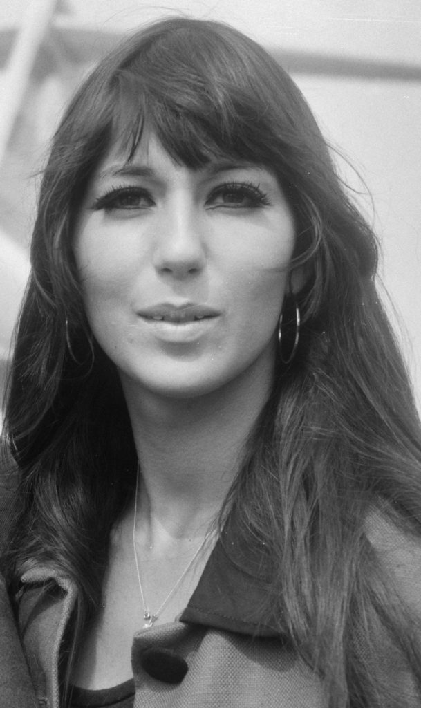 A young Cher leaving the airport in 1966.