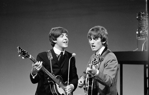 A young Paul McCartney and George Harrison in 1964.