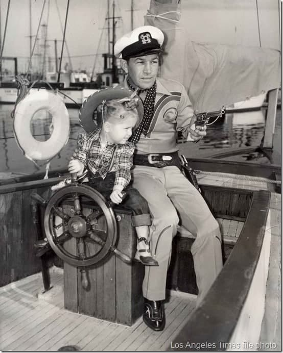 Spade Cooley and his daughter Melody pose for a publicity photo aboard his yacht.