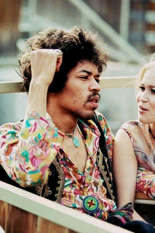 Jimi Hendrix sits next to Carmen Borrero in a Pool Box seat during afternoon sound check at the Hollywood Bowl, California, US, September 14, 1968. Photo by Ed Caraeff.