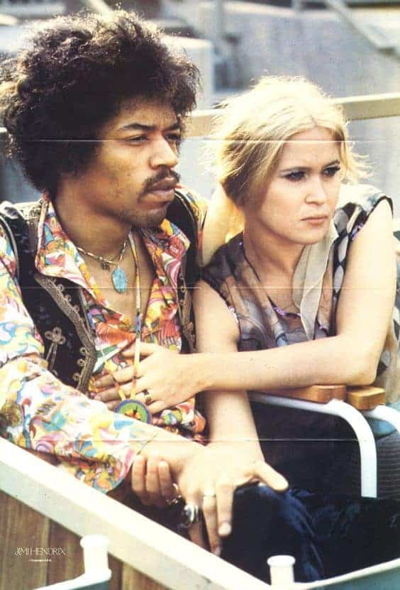 American guitarist Jimi Hendrix (1942 – 1970) sits next to Carmen Borrero in a Pool Box seat during afternoon sound check at the Hollywood Bowl, California, US, September 14, 1968.