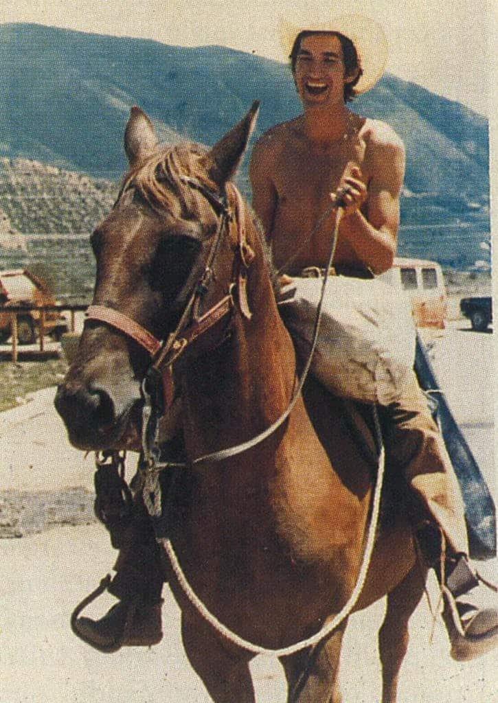 Townes Van Zandt riding a horse.