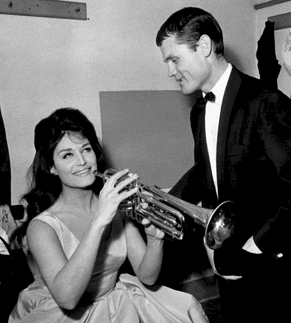 Dalida and Chet Baker in her dressing room at the Rome Brancaccio theatre before a concert in which the two artists performed together, Italy (1962).