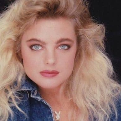 Erika Eleniak model and actress posing for photograph.