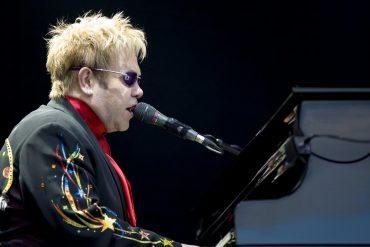 Elton John performing live